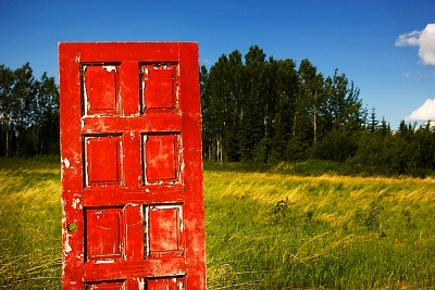 A red door that apparently exists in Alberta, Canada.